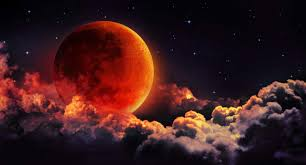 Blood moon slipping behind some clouds Google Images