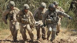 Combat team carry a team member on a stretcher. Google Images